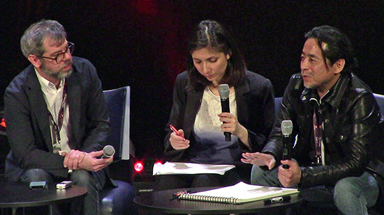 Kazuki Takahashi speaking at his Q&A panel at MAGIC 2019, with Matthieu Pinon and Sahé Cibot