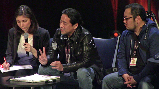 Kazuki Takahashi speaking at his Q&A panel at MAGIC 2019, with Sahé Cibot and Naoki Kawashima
