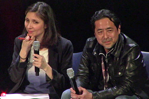 Sahé Cibot and Kazuki Takahashi looking at the audience at MAGIC 2019 at Takahashi's Q&A panel