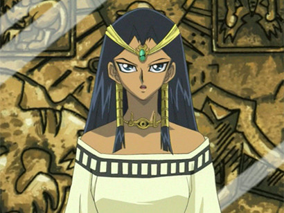 Ishizu Ishtar standing in front of an ancient Egyptian stone carving in episode 52