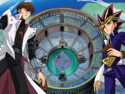 Yugi and Kaiba facing off with an overhead view of Kaiba's Duelist Coliseum in the background in Yu-Gi-Oh! episode 129