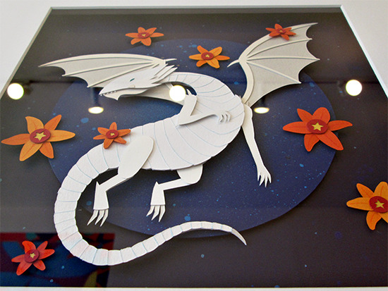 Low-angle shot of the Blue-Eyes White Dragon paper collage by Meghan Stratman at the Gallery1988 Yu-Gi-Oh! art show