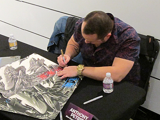 Anthony Petrie signing an autograph at the Yu-Gi-Oh! Tribute Art Show NYC