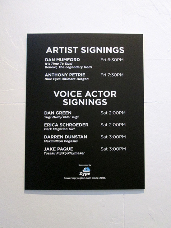 Sign showing the autograph schedule at the Yu-Gi-Oh! Tribute Art Show NYC