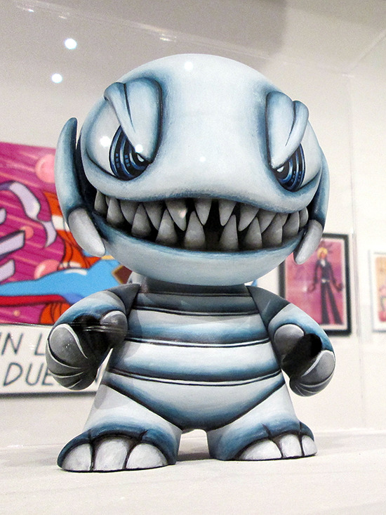 Close-up of Blue-Eyes Toon Dragon figure on display at the Yu-Gi-Oh! Tribute Art Show NYC