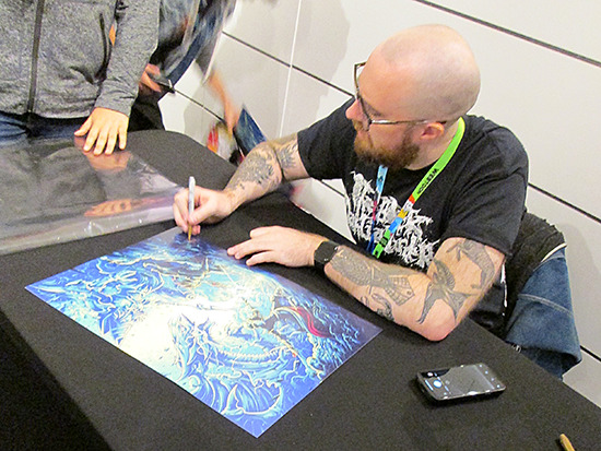 Dan Mumford signing an autograph at the Yu-Gi-Oh! Tribute Art Show NYC