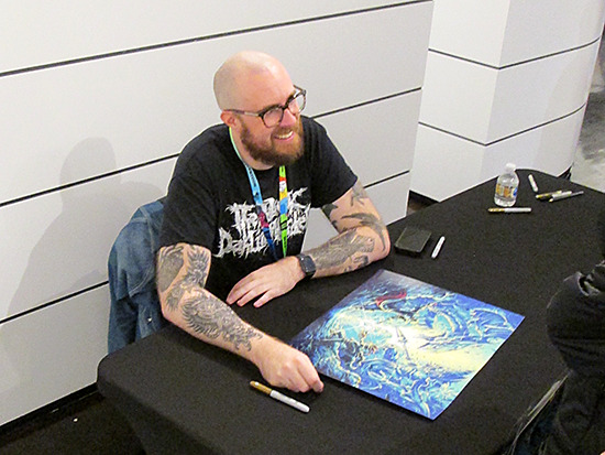 Dan Mumford smiling during his signing at the Yu-Gi-Oh! Tribute Art Show NYC