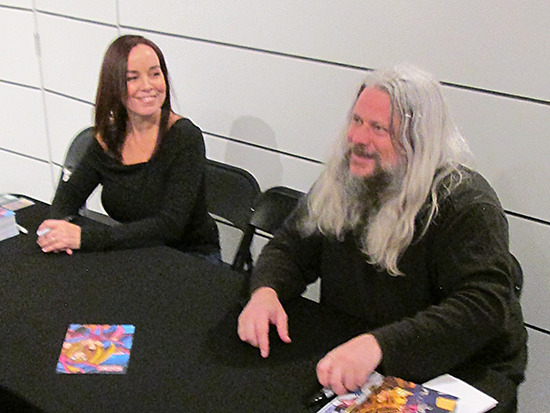 Erica Schroeder and Dan Green smiling and chatting with fans at the Yu-Gi-Oh! Tribute Art Show NYC
