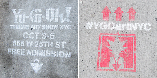 Two different spray-painted sign advertising the Yu-Gi-Oh! Tribute Art Show NYC on the pavement