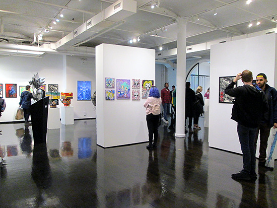 Visitors looking at art and walking around the gallery at the Yu-Gi-Oh! Tribute Art Show NYC
