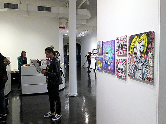 Visitors around Scary Yugi and other works at the Yu-Gi-Oh! Tribute Art Show NYC