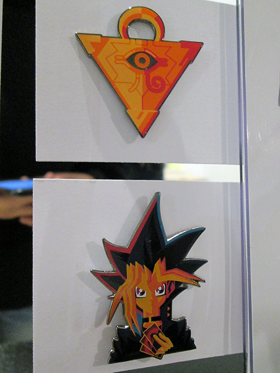 Close-up of the Millennium Puzzle and Yugi pins based on Tom Whalen's King of Games