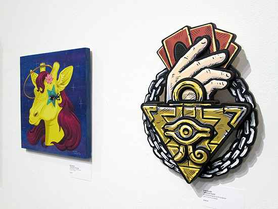 Performapal Changeraffe and Millennium Puzzle on display at the Yu-Gi-Oh! Tribute Art Show NYC