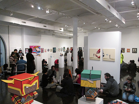 Another view of the inside of the gallery showing the many people lined up for the voice actors' signing event at the Yu-Gi-Oh! Tribute Art Show NYC