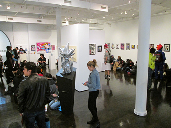 Yet another view of the inside of the gallery showing the people lined up for the voice actors' signing event at the Yu-Gi-Oh! Tribute Art Show NYC