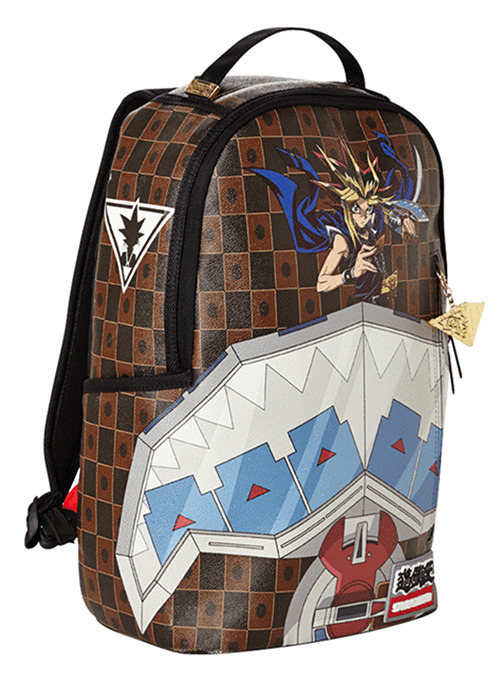 Three-quarter view of Sprayground's Yu-Gi-Oh! Duel Disk backpack