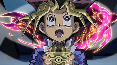 Shadow creatures materializing around Yugi in the remastered version of Yu-Gi-Oh! The Movie