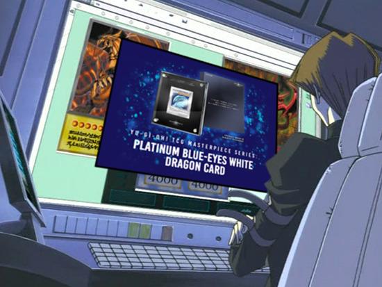 Seto Kaiba looking at the Yu-Gi-Oh! TCG Masterpiece Series: Platinum Blue-Eyes White Dragon on his computer monitor
