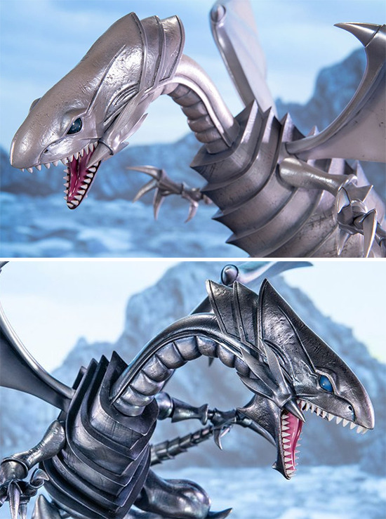 Close-up of the upper bodies of First 4 Figures' Blue-Eyes White Dragon Standard White and Silver Edition PVC figures