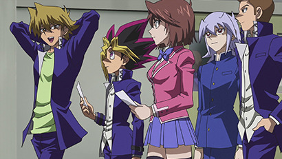 Yugi and his friends walking through a hallway at school in Yu-Gi-Oh! The Dark Side of Dimensions